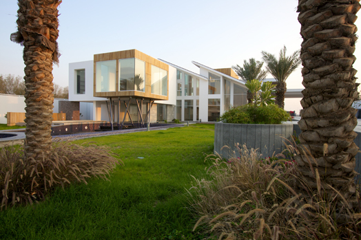 Twin-sloped roof Bungalow in Bahrain by Moriq Architects