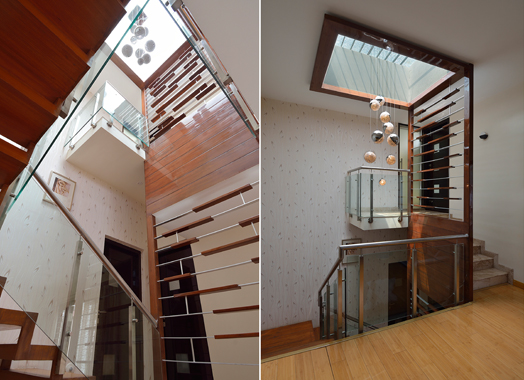 stairwell with skylight and decorative railing