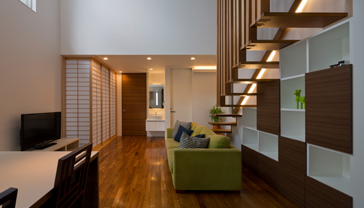 optimum space planning - bookshelves under staircase
