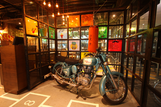 hopsctoch and a Royal Enfield bike evoke nostalgia