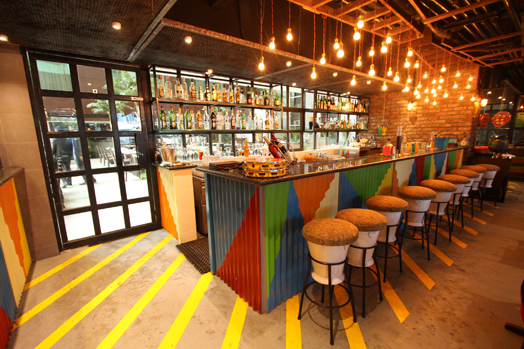corrugated metal sheets as bar counter wrapping
