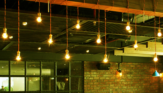 exposed hanging bulbs as industrial decor