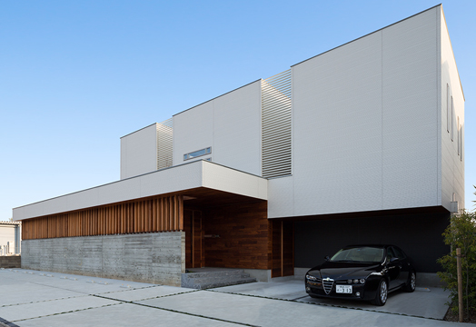 home exteriors of wood and concrete
