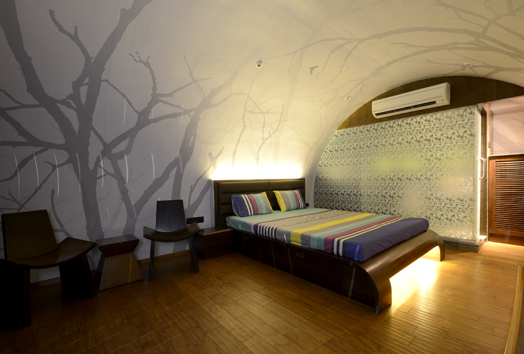 bed with backlit headboard and curved lit footboard