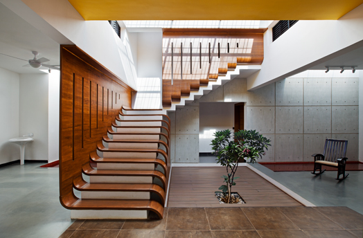 teak wood staircase treated as a sweeping design element