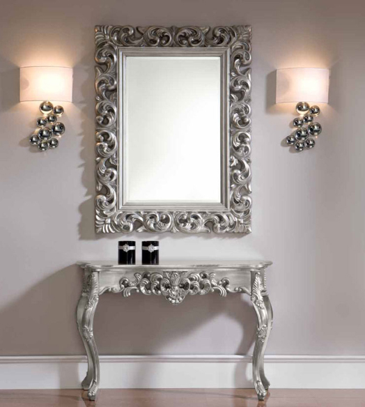 silver edged mirror frame and dresser