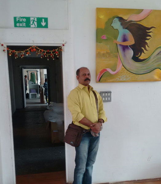 Artist Arun Awasarmol with his exhibit at LDF 2015