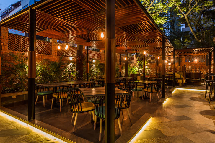 """outdoor seating under pergolas mr baozi sumessh menon associates indiaartndesign"""