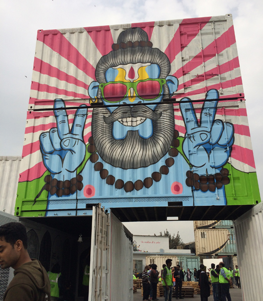 hipster painting on container at st+art festival delhi