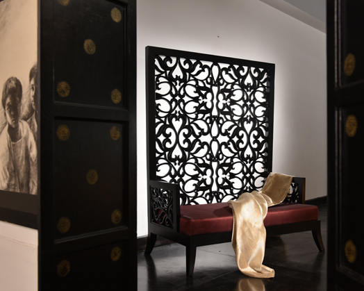 High-back chair with 3-dimensional solid teak wood jaali in black matt finish