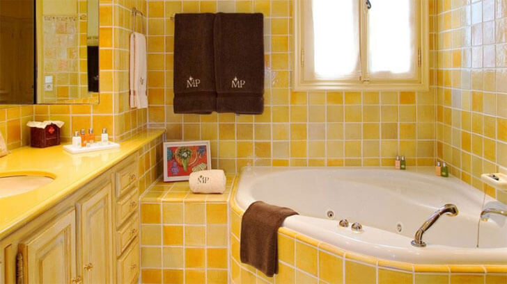 """yellow bathroom with orange coloured accents indiaartndesign"""
