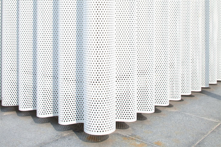 corrugated and perforated polyester powder-coated aluminium skin.