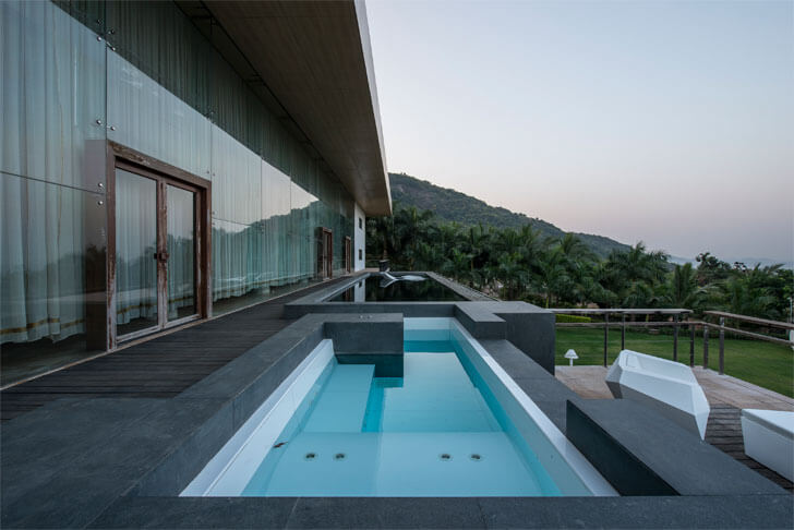 """glass façade pool Aurelia house under a pool shroffleon indiaartndesign"""