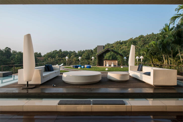 """lawn seating barbeque Aurelia house under a pool shroffleon indiaartndesign"""