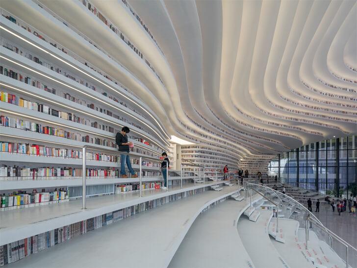 """continuous bookshelves tianjin binhai library MVRDV indiaartndesign"""