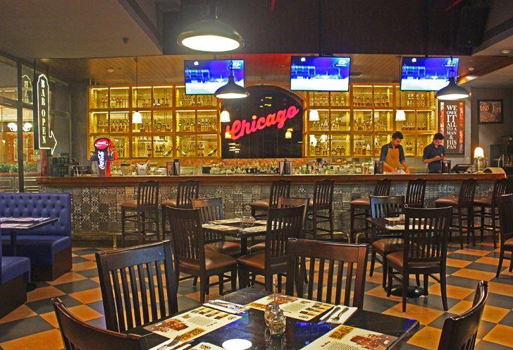 """bar with tin tiles Uno pizzeria Bengaluru chromed design studio indiaartndesign"""
