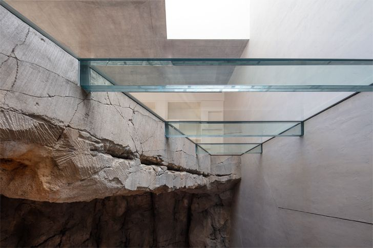 """glass inserts into rock Villa Troglodyte JPL Architects indiaartndesign"""