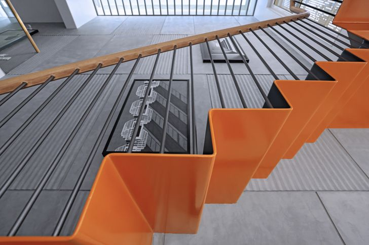 """orange colour on staircase Porwal Residence DipenGadaAssociates indiaartndesign"""