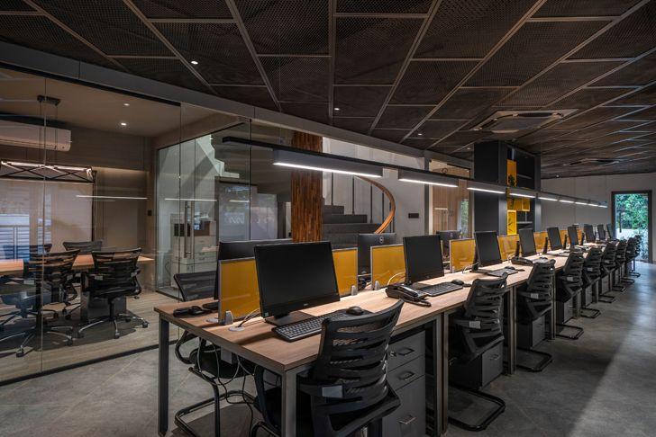 """long central workstation Numi office hyderabad Urban Zen Architects indiaartndesign"""